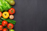 Healthy eating ingredients: fresh vegetables, fruits and superfood. Concrete background