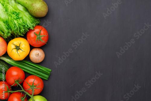 Fototapeta Healthy eating ingredients: fresh vegetables, fruits and superfood. Concrete background obraz
