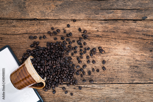 Valokuvatapetti Glass coffee beans books books on the desk top view