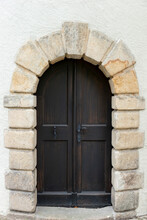 Old Wooden Door With A Frame Made Of Sandstone