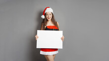 Young Woman Dressed In Santa C...