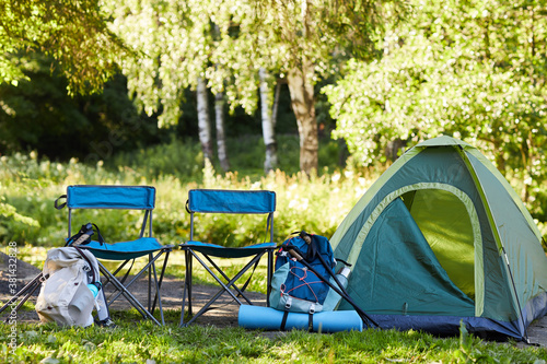 Background image of empty tent and camping gear on camping site in forest, copy Fotobehang