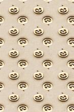Jack O Lanterns Pumpkin  On A Beige Background. Halloween Pattern. Festive Background.