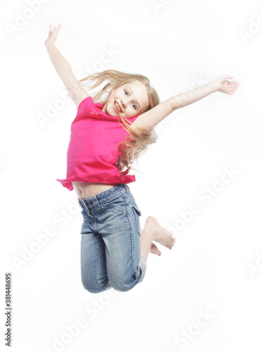 Photo girl jumps on a white background