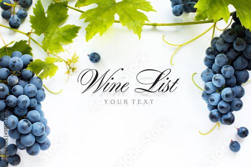 Fototapeta wine list background; sweet black grapes and red wine bottle obraz