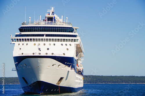 Modern luxury cruiseship or cruise ship liner anchoring on blue sea in bay offsh Wallpaper Mural