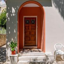 Colorful Magenta Arched Portico Entrance Natural Wood Door