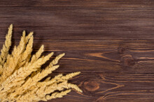 Spikelets On A Wooden Backgrou...