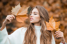 Woman In A Autumn Park. Lady W...