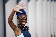 Fit African Woman Covers Face ...