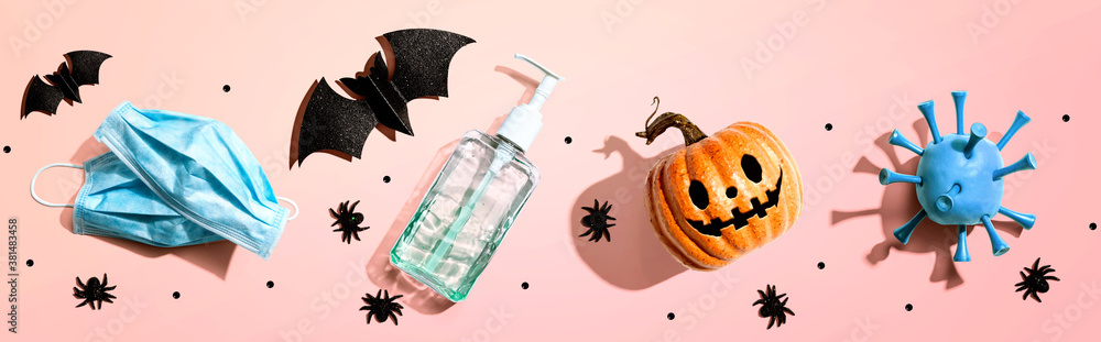 Fototapeta Masks and sanitizer bottle with Halloween objects - healthcare and hygiene concept