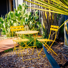 Yellow Chairs And Table In Zero Scape Garden With Rocks, And Cactus