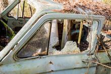 Broken Window In An Abandoned Car/broken Glass In An Abandoned Car
