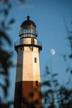 Golden Sunset Light Hitting The Side Of A Tall Stone Lighthouse. Montauk Point, New York