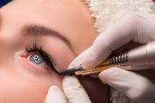 Permanent Eye Makeup Close Up Shot. Cosmetologist Applying Tattooing Of Eyes. Makeup Eyeliner Procedure