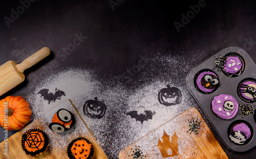 Cooking delicious homemade cake and decorate cupcake for Halloween festive Fototapet