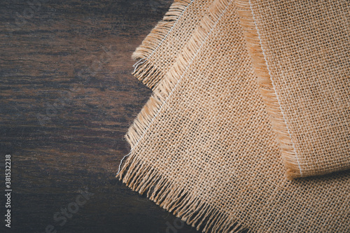 vintage hemp sack tablecloth on the old dark wooden table Canvas Print