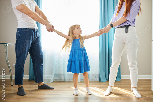 Fotografia sad daughter feeling upset about parents divorce, caucasian child girl suffer fr