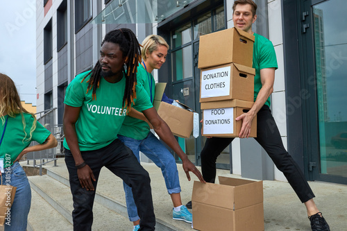 Valokuvatapetti friendly interracial charity group engaged in voluntary, they stand outdoors on