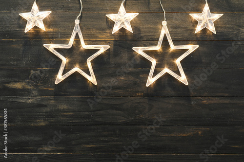 Beautiful Christmas garland on wooden background