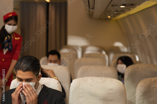 Fototapeta Business men and seated passengers ready to leave There is a flight attendant service