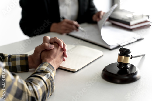 Fototapeta Counselor with legal documents discussing with client about legacy case. obraz