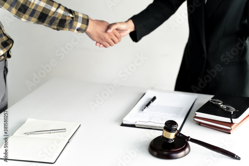Fototapeta Counselor hand shaking with client successful legal contract.