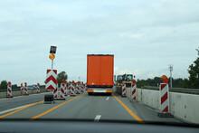 A Truck Drives Through A Const...
