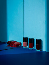 Still Life Of Nail Polish In Front Of A Mirror