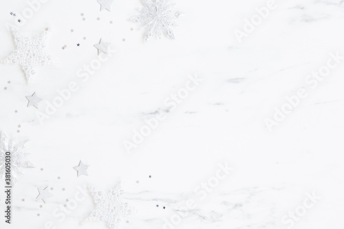 Fototapeta Christmas composition. Silver decorations on marble background. Christmas, winter, new year concept. Flat lay, top view, copy space obraz