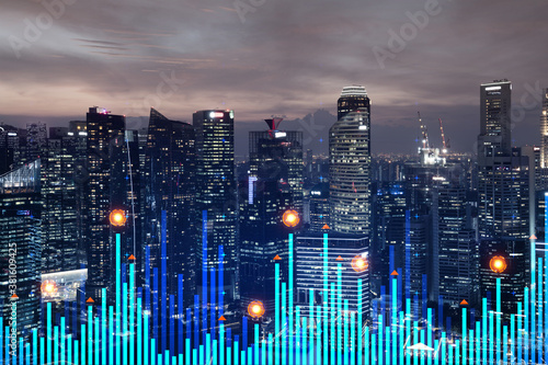 Fototapeta Market behavior graph hologram, sunset panoramic city view of Singapore, popular location to achieve financial degree in Asia. The concept of financial data analysis. Double exposure.