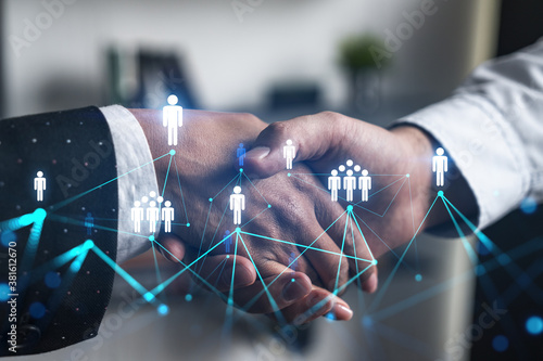 Double exposure of two businesspeople handshake and social media network icon hologram drawing background Canvas Print