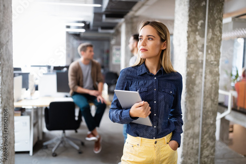Beautiful business woman holding tablet computer in office Canvas Print