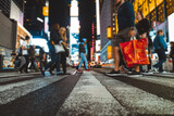 Fototapeta Nowy Jork - Time square at night, blurried concept photo in New york