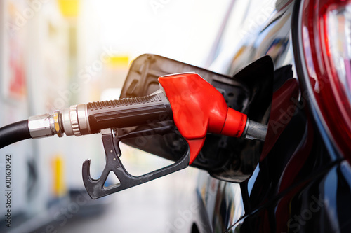 Obraz na plátně Refilling and pumping gasoline oil the car with fuel at he refuel station