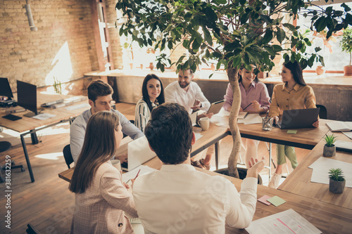 Foto Positive successful manager marketer lawyer sit table have business start up app