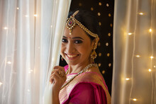 Beautiful Bride Smiling From The Curtain