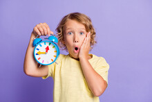 Photo Of Frustrated Kid Feel Worried Show Clock Missed Late Time Concept Isolated Over Purple Color Background