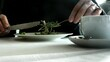 Woman eating sunflower sprouts salad in white dish on the table. 4K