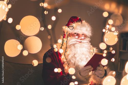 Fototapeta Santa Claus reading a book obraz