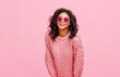 Happy ethnic woman in sunglasses laughing.