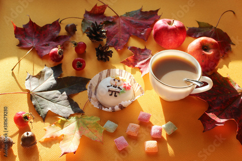 Apples, nuts, foliage, rosehip fruit with a Cup of cocoa and cake, close-up, side view