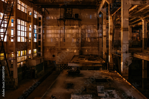 Dark creepy empty abandoned industrial building interior at night Wallpaper Mural
