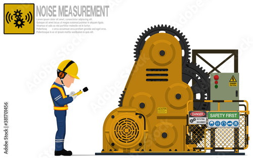 An industrial worker is measuring sound level of the rolling machine