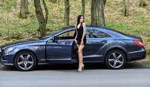 Driver Lady. Beauty And Fashion. Woman In Sexy Dress. My Car Is Broken. Defenseless Naive Girl Needs Help. Sexy Girl Elegant Dress At Road. Sexy Girl And Luxury Car. Escort And Sexual Services