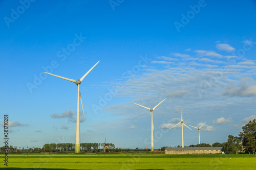 Fotomural Dutch polder landscape with modern windturbines for the sustainable production o