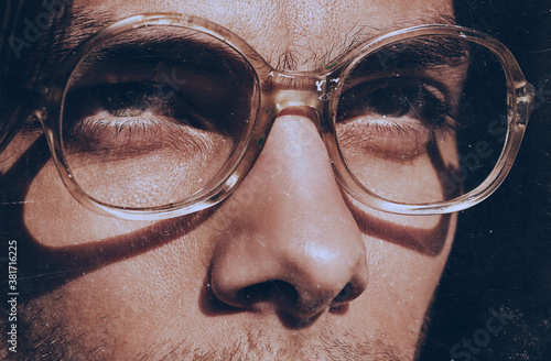 Obraz na plátne eyes of handsome man in old fashioned glasses