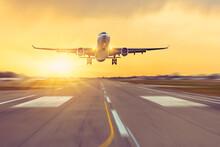 Airplane Landing On Runway Speed, Sunset On Background.