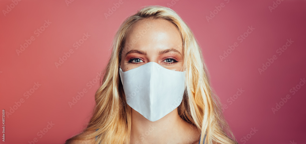 Fototapeta Blonde woman in a protective face mask