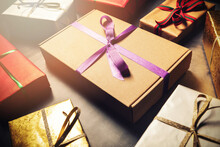 Gift Wrapping Service - Wrapped Present Boxes On Dark Table